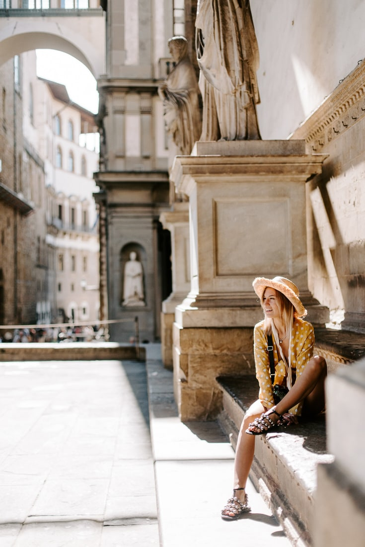 florence woman sitting on the street
