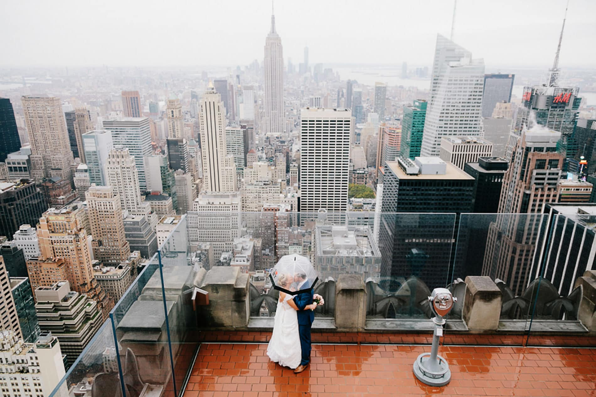couple under umbrella on the roof