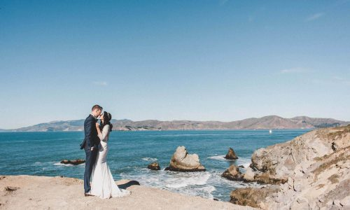 sutro baths photoshoot wedding photosession couple in front of ocean view main